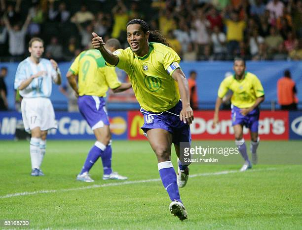 Ronaldinho of Brazil celebrates scoring his team's third goal during the FIFA 2005 Confederations Cup Final between Brazil and Argentina at the...