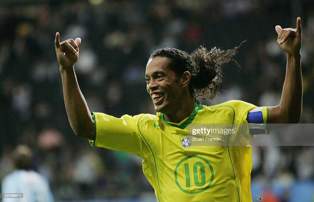 Ronaldinho of Brazil celebrates scoring his team's third goal during the FIFA 2005 Confederations Cup Final between Brazil and Argentina at the Waldstadion on June 29, 2005, in Frankfurt, Germany.