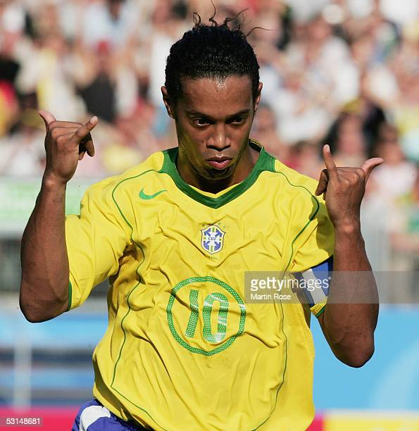 Ronaldinho of Brazil celebrates scoring the second goal from the penalty spot during the semi final match between Germany and Brazil for the FIFA...
