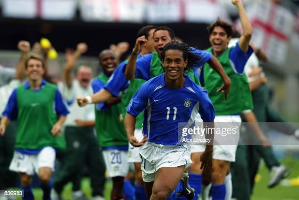 Ronaldinho of Brazil celebrates scoring the winning goal during the FIFA World Cup Finals 2002 Quarter Finals match between England and Brazil played...