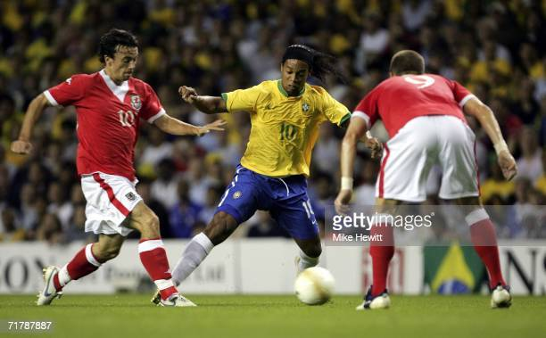 Ronaldinho of Brazil is challenged by Simon Davies and Carl Robinson of Wales during the International friendly match between Brazil and Wales at...