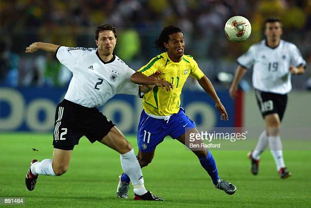 Ronaldinho of Brazil is challenged by Thomas Linke of Germany during the Germany v Brazil, World Cup Final match played at the International Stadium...