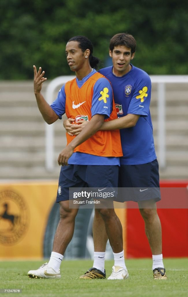 Ronaldinho of Brazil is held by Kaka of Brazil during the Brazil National Football Team training session for the FIFA World Cup Germany 2006 at the Paffrather Street Stadium on June 20, 2006 in Bergisch Gladbach, Germany.