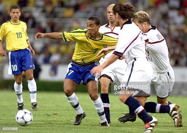 Ronaldinho of Brazil is held by US players during their match 28 July 1999 in Guadalajara Ronaldinho goleador de la seleccion brasilera es detenido...
