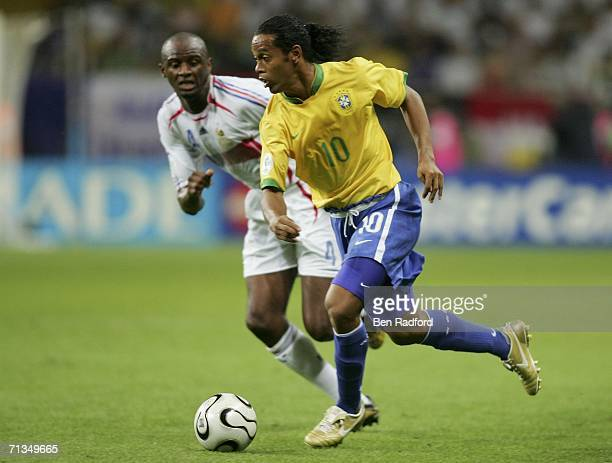 Ronaldinho of Brazil is pursued by Patrick Vieira of France during the FIFA World Cup Germany 2006 Quarterfinal match between Brazil and France at...