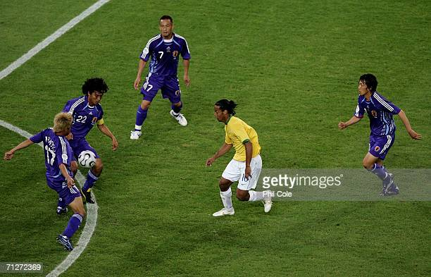 Ronaldinho of Brazil is surrounded by Japan players during the FIFA World Cup Germany 2006 Group F match between Japan and Brazil at the Stadium...
