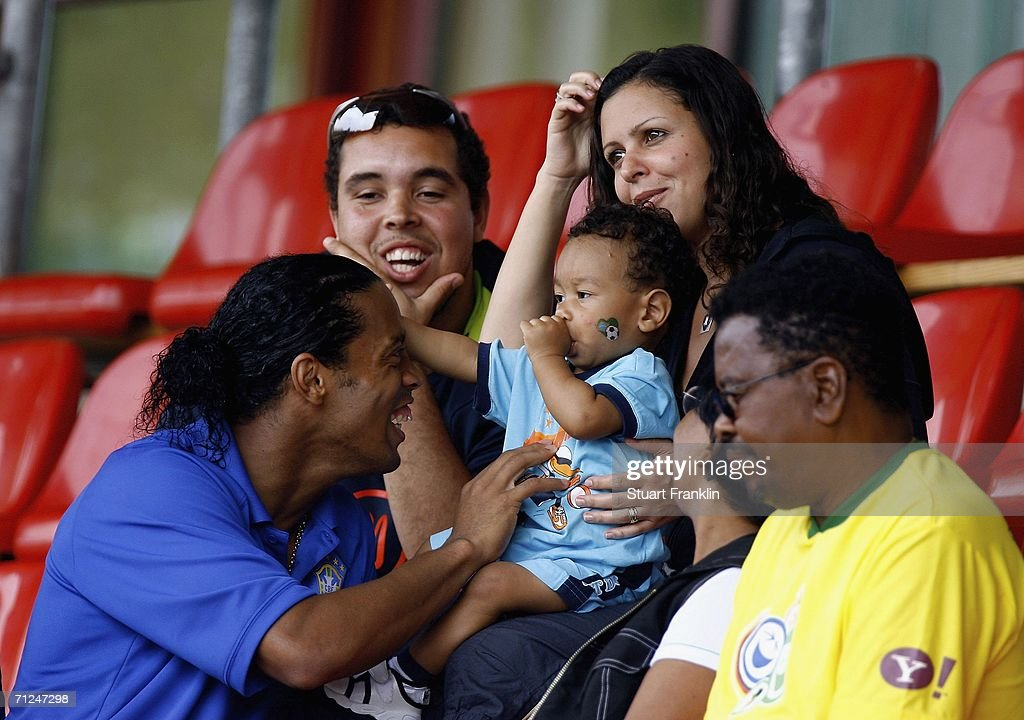 Ronaldinho of Brazil meets the family of his team mate Juan during the Brazil National Football Team training session for the FIFA World Cup Germany 2006 at the Paffrather Street Stadium on June 20, 2006 in Bergisch Gladbach, Germany.