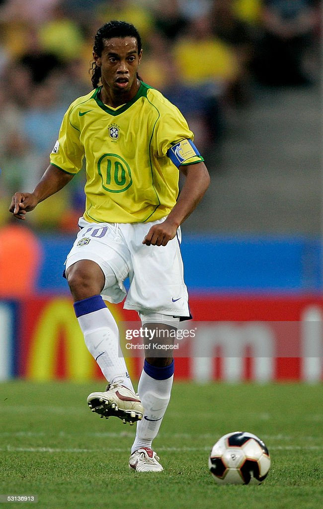 Ronaldinho of Brazil passes the ball during the match between Japan and Brazil for the Confederations Cup 2005 at the RheinEnergie Stadium on June 22, 2005 in Cologne, Germany.