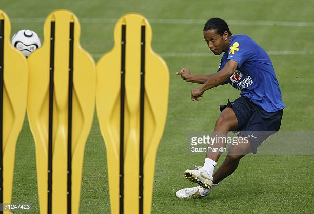 Ronaldinho of Brazil practices take a fee kick against a wall of plastic players during the Brazil National Football Team training session for the...