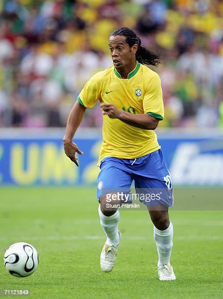 Ronaldinho of Brazil runs with the ball during the international friendly match between Brazil and New Zealand at the Stadium de Geneva on June 4,...