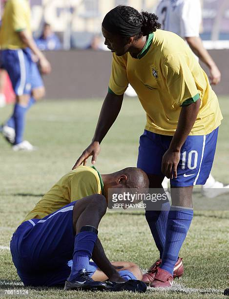 Ronaldinho of Brazil stands over teammate Afonso after he was injured against the US during the second half of their friendly soccer match 09...