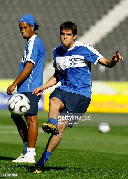 Ronaldinho of Brazil watches Kaka kick a ball during the Brazilian National Team training session for the FIFA World Cup 2006 at The Olympic Stadium...