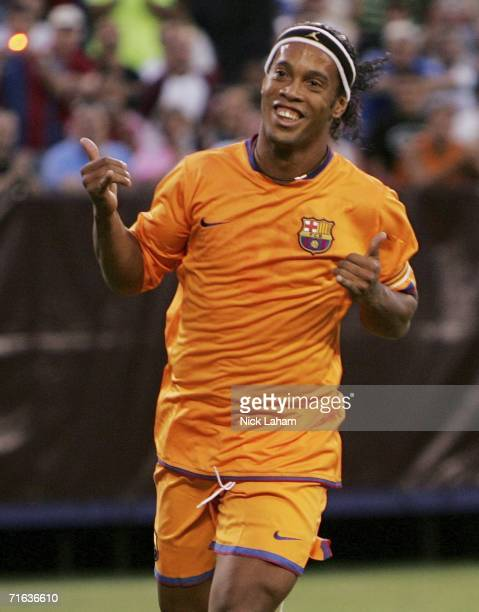 Ronaldinho of FC Barcelona celebrates scoring the first goal from a penalty against the New York Red Bulls during their International Friendly Match...