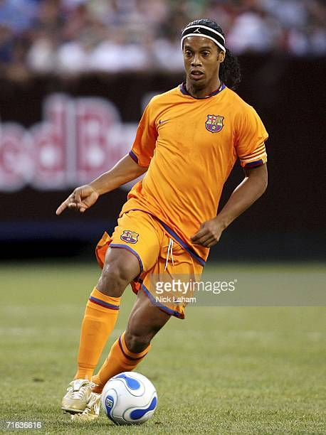 Ronaldinho of FC Barcelona dribbles the ball against the New York Red Bulls during their International Friendly Match on August 12 2006 at Giants...