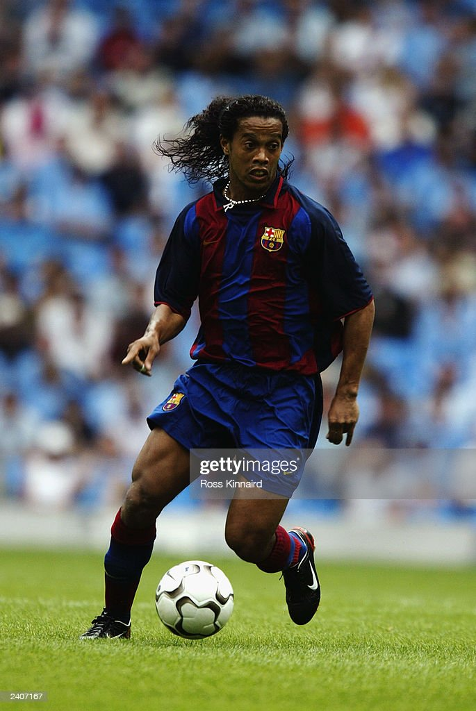 Ronaldinho of FC Barcelona runs with the ball during the Pre-Season Friendly match between Manchester City and FC Barcelona held on August 10, 2003 at The City of Manchester Stadium, in Manchester, England. Manchester City won the match 2-1.