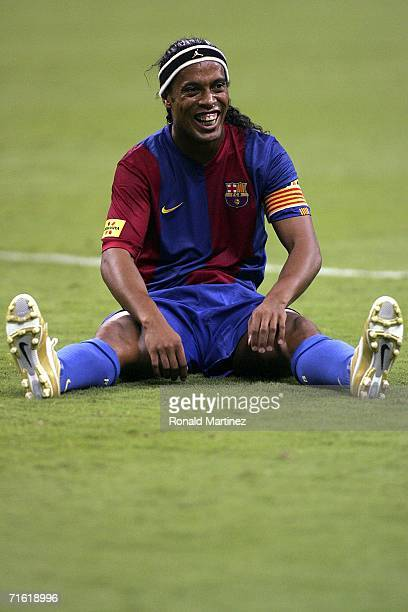 Ronaldinho of FC Barcelona smiles after a collision with Ricardo Rojas of Club America on August 9, 2006 at Reliant Stadium in Houston, Texas. FC...