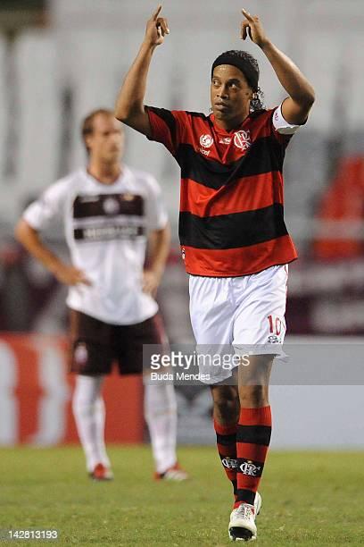 Ronaldinho of Flamengo celebrates a scored goal of Luis Antonio againist Lanus during a match between Flamengo and Lanus as part of the Copa...