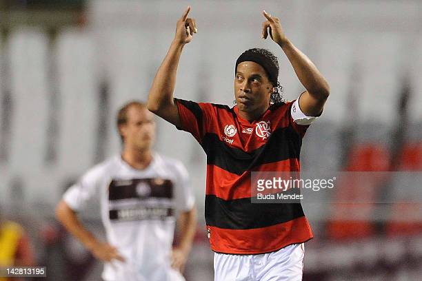 Ronaldinho of Flamengo celebrates a scored goal of Luis Antonio againist Lanus during a match between Flamengo and Lanus as part of the Copa...