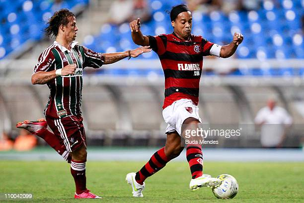 Ronaldinho of Flamengo struggles for the ball with Dieguinho of Fluminense during a match as part of Rio de Janeiro State Championship 2011 at...