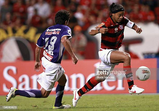 Ronaldinho of Flamengo struggles for the ball with Rony Jimenez of Real Potosi during a match between Flamengo and Real Potosi as part of Santander...
