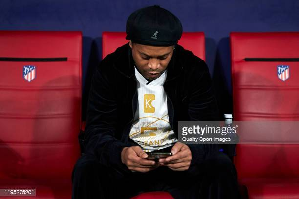 Ronaldinho of Goldstandard checks his phone during a friendly match at Wanda Metropolitano on December 21 2019 in Madrid Spain