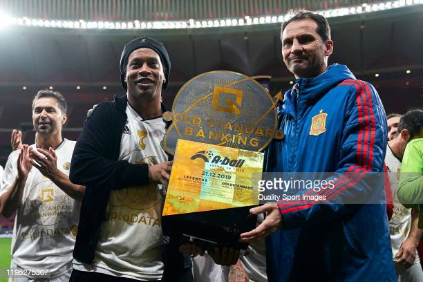 Ronaldinho of Goldstandard poses with a trophy during a friendly match at Wanda Metropolitano on December 21 2019 in Madrid Spain