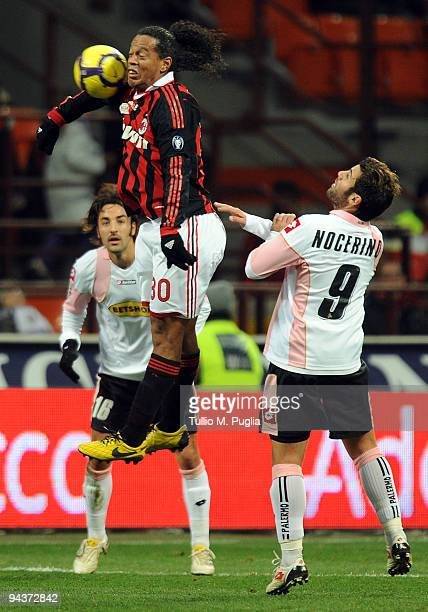 Ronaldinho of Milan and Antonio Nocerino of Palermo compete for the ball during the Serie A match between AC Milan and US Citta di Palermo at Stadio...