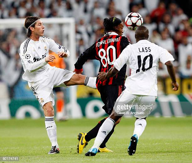 Ronaldinho of Milan is challenged by Sergio Ramos and Lassana Diarra of Real Madrid during the UEFA Champions League Group C match between Real...