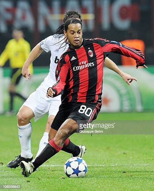 Ronaldinho of Milan runs with the ball during the Uefa Champions League group G match between Milan and Real Madrid at Stadio Giuseppe Meazza on...