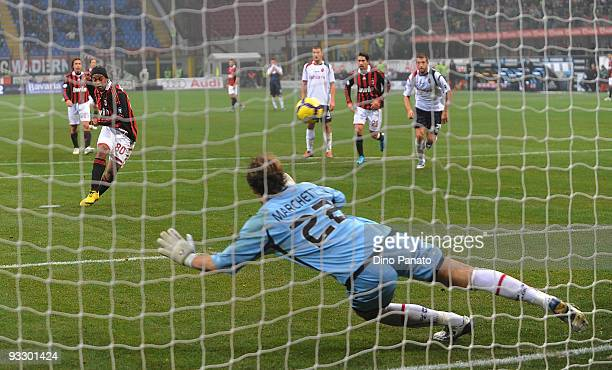 Ronaldinho of Milan scores the fourth goal from the penality spot during the Serie A match between Milan and Cagliari at Stadio Giuseppe Meazza on...