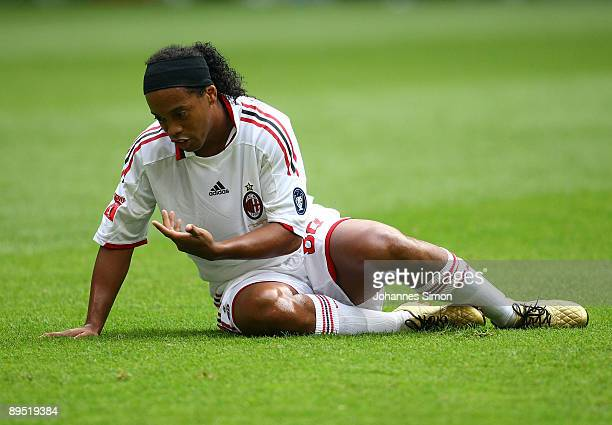 Ronaldinho of Milan sits on the pitch during the Audi Cup tournament final match for the third place Boca Juniors v AC Milan at Allianz Arena on July...