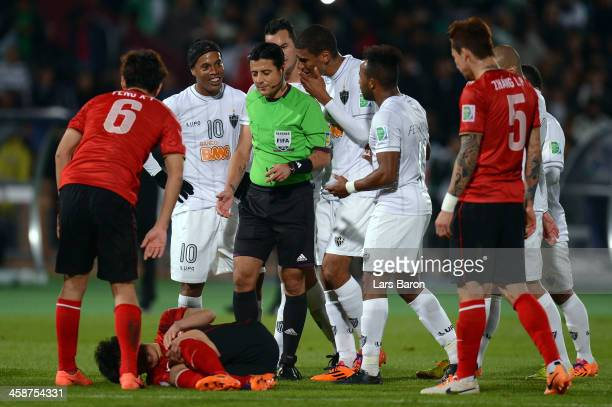 Ronaldinho of Mineiro discusses with referee Alireza Faghani reciewing the red card during the FIFA Club World Cup 3rd Place Match between Guangzhou...