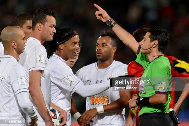 Ronaldinho of Mineiro is sent off the pitch by referee Alireza Faghini during the FIFA Club World Cup soccer match for third place between Guangzhou...