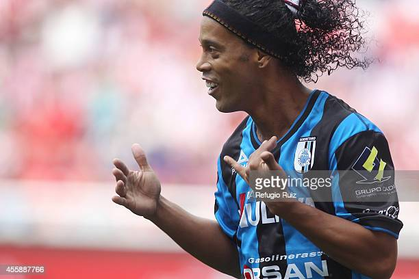 Ronaldinho of Queretaro celebrates after scoring the opening goal from the penalty spot during a match between Chivas and Queretaro as part of 9th...