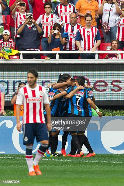 Ronaldinho of Queretaro celebrates with his teammates after scoring the opening goal from the penalty spot during a match between Chivas and...