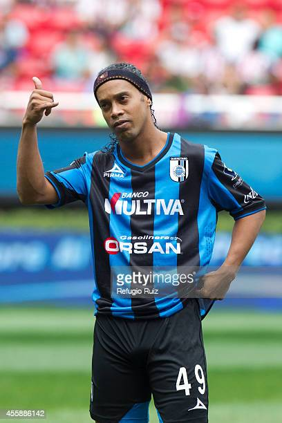 Ronaldinho of Queretaro greets fans of Queretaro prior to a match between Chivas and Queretaro as part of 9th round Apertura 2014 Liga MX at Omnilife...