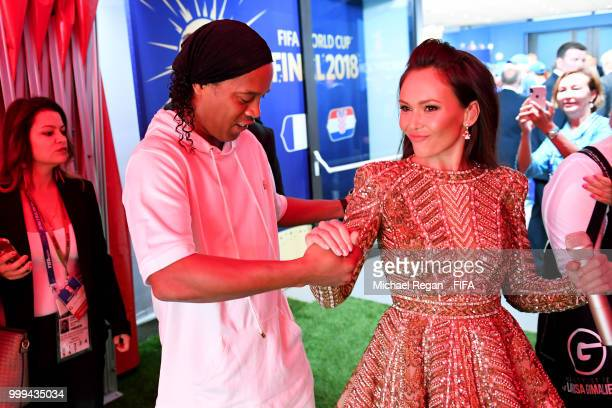 Ronaldinho shakes hands with Opera singer Aida Garifullina in the tunnel prior to the 2018 FIFA World Cup Final between France and Croatia at...