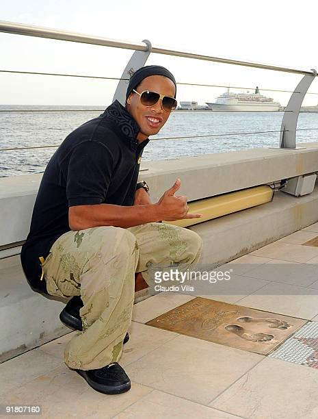 Ronaldinho winner of the 2009 Golden Foot Award poses for a photograph at the the Golden Foot Promenade at Monte Carlo on October 12 2009 in Monaco...
