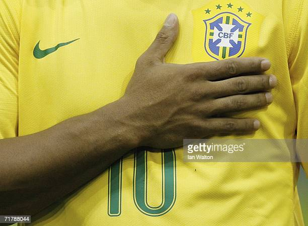 Ronaldino holds the brazil crest during the national anthem during the International Friendly between Brazil and Wales on September 5 2006White Hart...