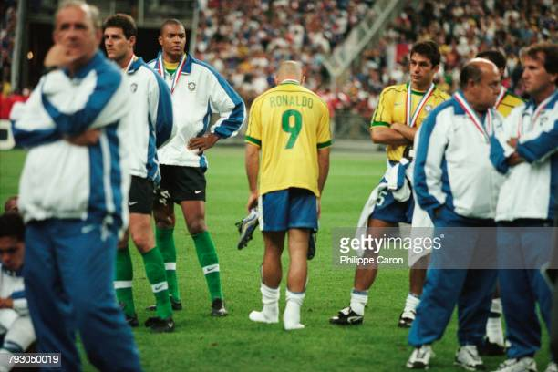 Ronaldo and his fellow players of Brazil look dejected after their 3-0 loss to France during the final match of the 1998 FIFA World Cup. | Location:...