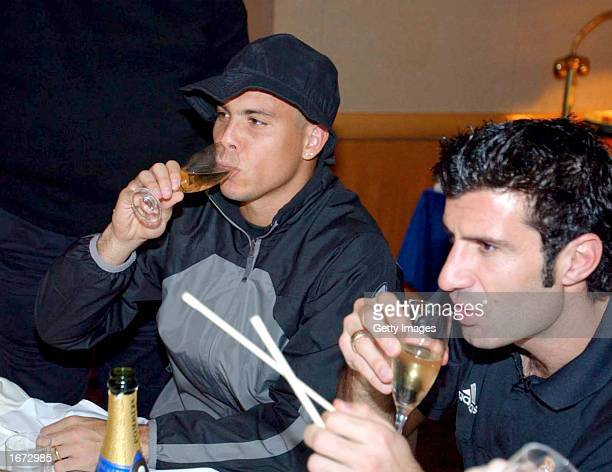 Ronaldo and Luis Figo of Real Madrid celebrate following victory in the Toyota Intercontinental Cup between Real Madrid and Olimpia played at the...