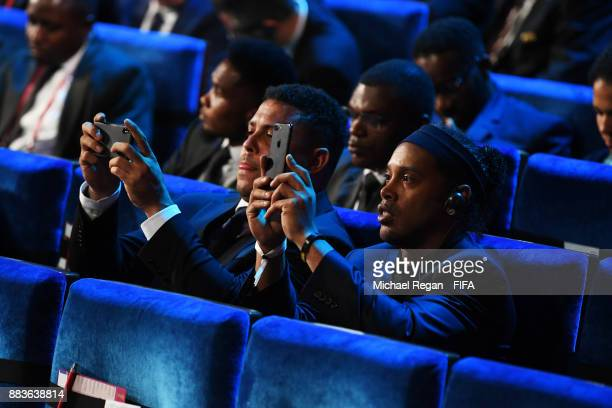 Ronaldo and Ronaldinho takes pictures during the Final Draw for the 2018 FIFA World Cup Russia at the State Kremlin Palace on December 1 2017 in...