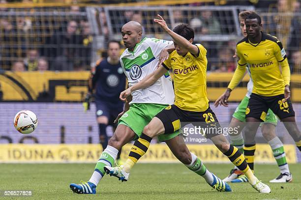 Ronaldo Aparecido Rodrigues of VFL Wolfsburg Shinji Kagawa of Borussia Dortmund during the Bundesliga match between Borussia Dortmund and VfL...