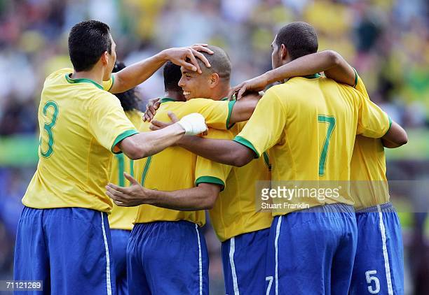 Ronaldo celebrates scoring his goal with teamates from Brazil during the international friendly match between Brazil and New Zealand at the Stadium...