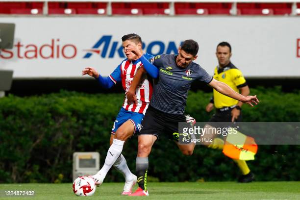 Ronaldo Cisneros of Chivas fights for the ball with Jesús Angulo of Atlas during the match between Chivas and Atlas as part of the friendly...