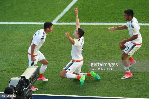 Ronaldo Cisneros of Mexico celebrates with his team mates Uriel Antuna and Eduardo Aguirre after scoring his team's winning goal during the FIFA U20...