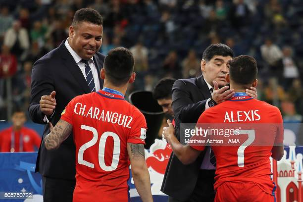 Ronaldo consoles Charles Aranguiz of Chile and Diego Maradona consoles Alexis Sanchez of Chile at the end of the FIFA Confederations Cup Russia 2017...