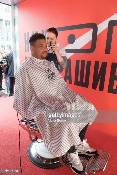 Ronaldo is having his haircut done at the barber shop at the opening of Box MSK at Gorky Park on June 12 2018 in Moscow Russia Brazil football icon...