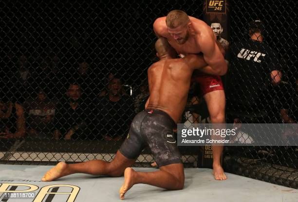 Ronaldo 'Jacare' Souza of Brazil attempts to take down Jan Blachowicz of Poland in their light heavyweight fight during the UFC Fight Night event at...