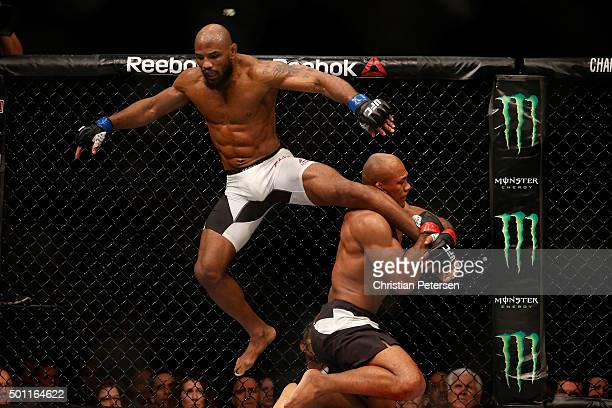 Ronaldo 'Jacare' Souza of Brazil attempts to take down Yoel Romero of Cuba in their middleweight bout during the UFC 194 event inside MGM Grand...
